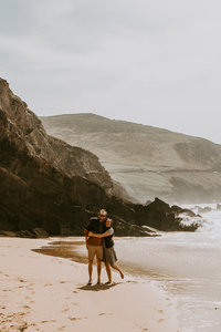 couple standing on beach