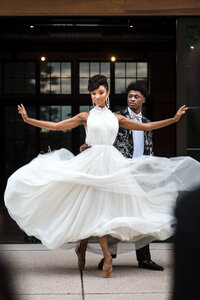 Black bride and groom ballet dancing