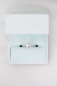Diamond engagement ring in something blue box photographed by top wedding photographer Rebecca Cerasani