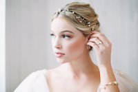 Blonde Woman in wedding gown with hair in updo