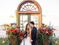 Bride and Groom in front of floral installation