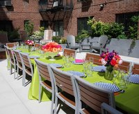 A colorful green outdoor event table setting.