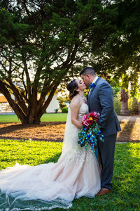 Bride and groom kiss at Granberry Hills wedding