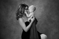 Studio portrait of mother and 9 month old baby taken at Melody Yazdani Studios in Vienna, Virginia