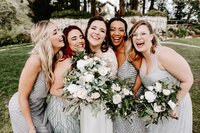 Laughing-bride-with-bridesmaids