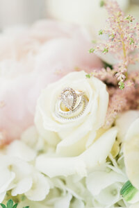 White rose with engagement ring in middle