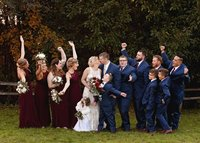 Wine bridesmaid dresses and Navy tuxedos