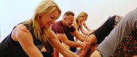helping with yoga adjustments- Soma Yoga Institute