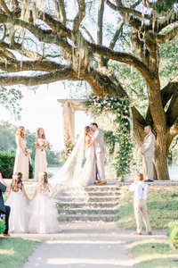 Charleston couple marries overlooking the Ashley River underneath an angel oak outside Charleston, SC