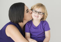kiss daughter-mother-purple-girl-glasses-love-studio-photo