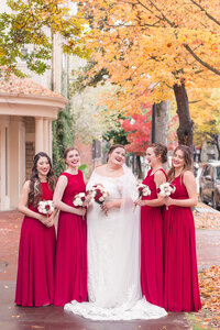 A bride poses with her bridesmaids at a Sterling Hotel Downtown Sacramento, CA wedding.