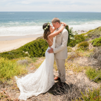 Bride and Groom embrace beachside