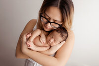 vietnamese-mother-cuddling-her-infant
