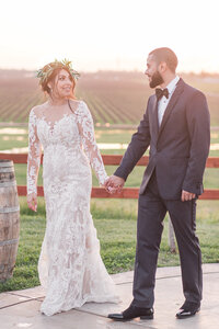 A bride and groom pose at their California winery wedding.