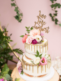 Wedding cake with decorative toppers
