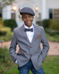 Young boy in bow tie smiles