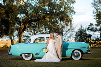 bride and groom with vintage car at sunnyside plantation in murrells inlet, south carolina
