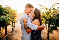 Vineyard engagement photography in Paso Robles vines by Amber McGaughey
