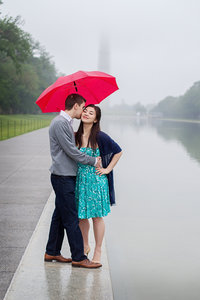 Engagement photo on the National Mall in the rain.  Image by top Washington DC wedding photographer Jalapeno Photography.
