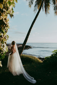 bride walking next to ocean