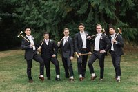 Groom and Groomsmen pose with crochet clubs
