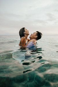 couple hugging in ocean