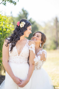 Same sex female couple embraces on wedding day
