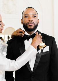 groom-black-tux-bowtie