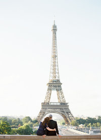 Couple embraces in front of Eiffel Tower