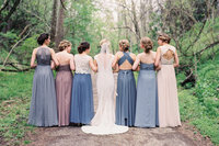 Bridesmaids with multi colored dresses