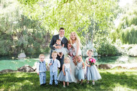 Bride and groom with ring bearers and flower girls