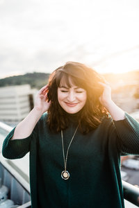 Portrait of Danielle Defayette Smith on top of the Bristol Hotel Lumac Rooftop Bar at Sunset