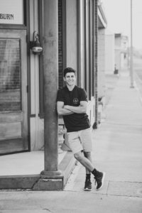 Senior boy posing in downtown Kennewick