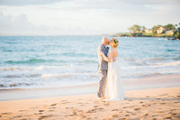 Maui wedding photographer photographs a couple's first kiss after getting married.