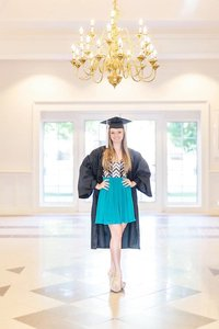 senior posing in cap and gown
