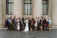 wedding party cheering for couple at nelson atkins museum