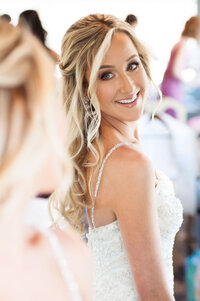 new jersey wedding photography for a lovely bride checking her hair and makeup