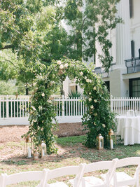 White rose arch with greenery