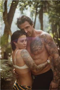 tatted-couple-hugging-in-forest@2x