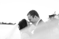 black and white portrait of bride and groom with veil by catie ann photography