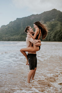 couple hugging in the ocean