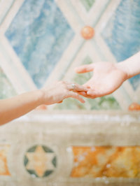 fine art wedding photographer holding hands