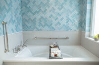 bathroom remodel blue herringbone tile