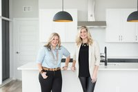Casual headshot of Nashville realtors in front of kitchen