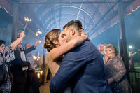 sparkler-exit-bride-and-groom-kissing-grand-exit-Monterey-California