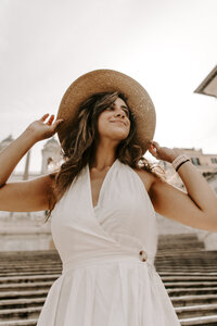 woman wearing white dress and hat