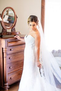 Bride taking in the moment after she put her dress on in the bridal suit at Elsie Perrin Williams Estate