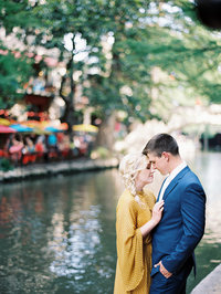 Young couple embraces  during New Orleans anniversary photography session