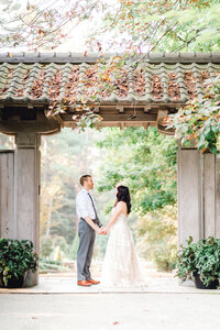 bride and groom holding hands at Duke gardens
