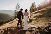 Couple walking up mountain side on Orcas Island for their wedding by Sarah Anne Photo